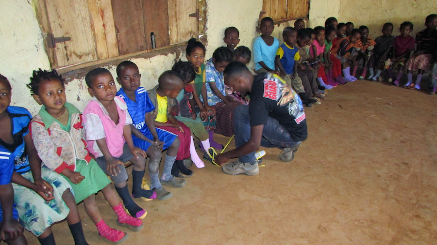 Children wait for Shoes to be Fitted
